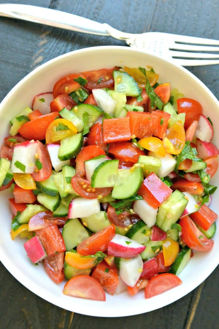 Overhead of bowl of Mediterranean Cucumber Salad with fork