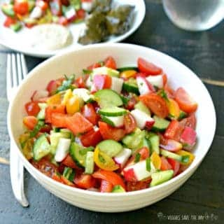 Mediterranean Cucumber and Tomato Salad is healthy, colorful, and easy to make with summer vegetables like bell peppers and radishes. Learn how to make it by visiting www.veggiessavetheday.com, or pin and save for later! Vegan | Gluten Free