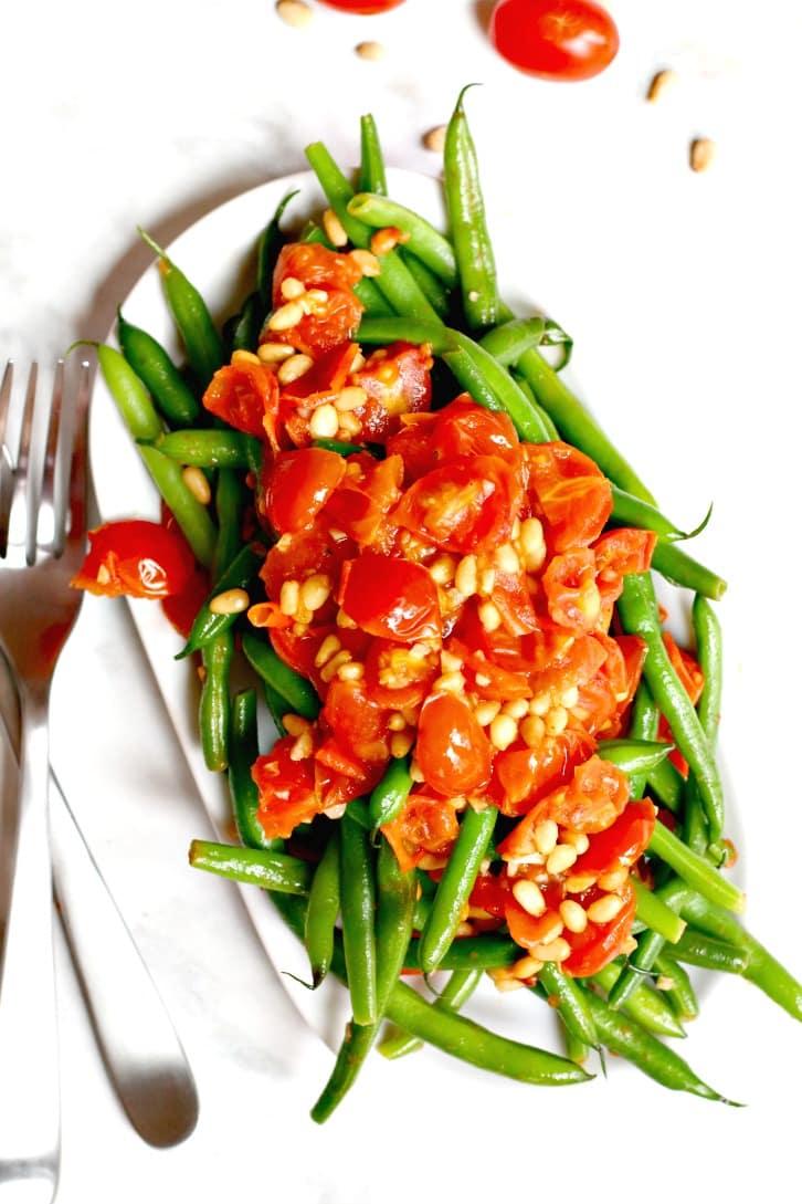 Sauteed Green Beans topped with garlicky tomatoes and pine nuts