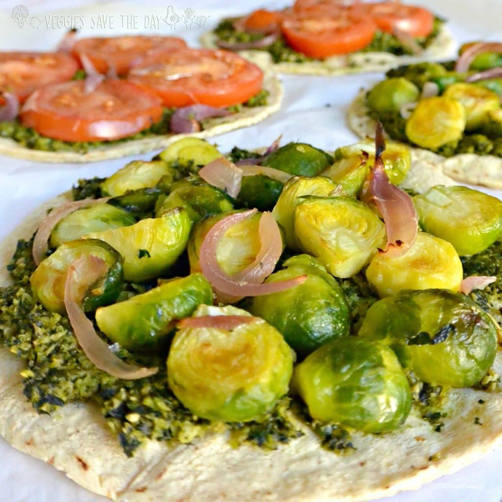 Tuesday calls for pizza topped with kale pesto, roasted Brussels sprouts and tomatoes in the BuzzFeed Trader Joe's Challenge