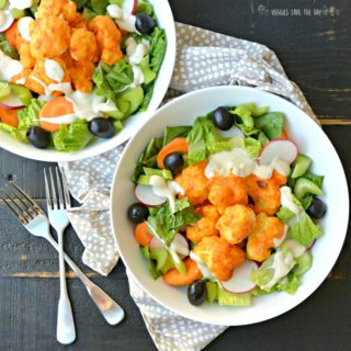 Buffalo Cauliflower Bites Salad is vegan and gluten free. Serve it with your favorite Ranch or Blue Cheese dressing for a flavorful meal!