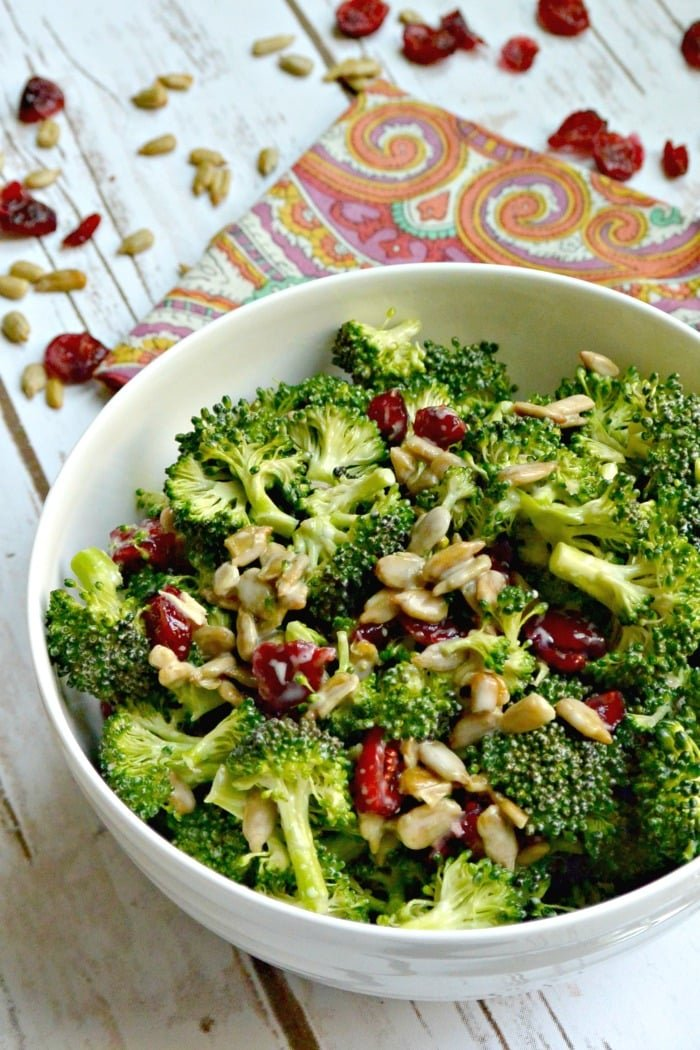 Bowl of Vegan Broccoli Salad with Dried Cranberries and Sunflower Seeds