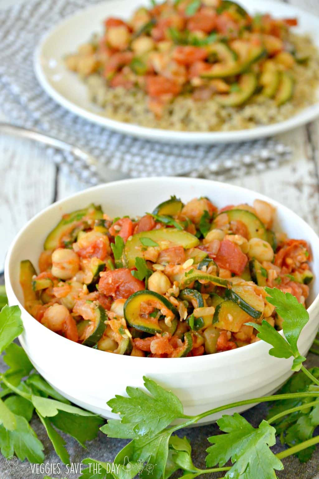 Bowl of Zucchini Chickpea Stew containing green zucchini squash, garbanzo beans, tomatoes, onion, garlic, smoked paprika, and fresh parsley. It's vegan, gluten-free, and can be prepared oil-free.