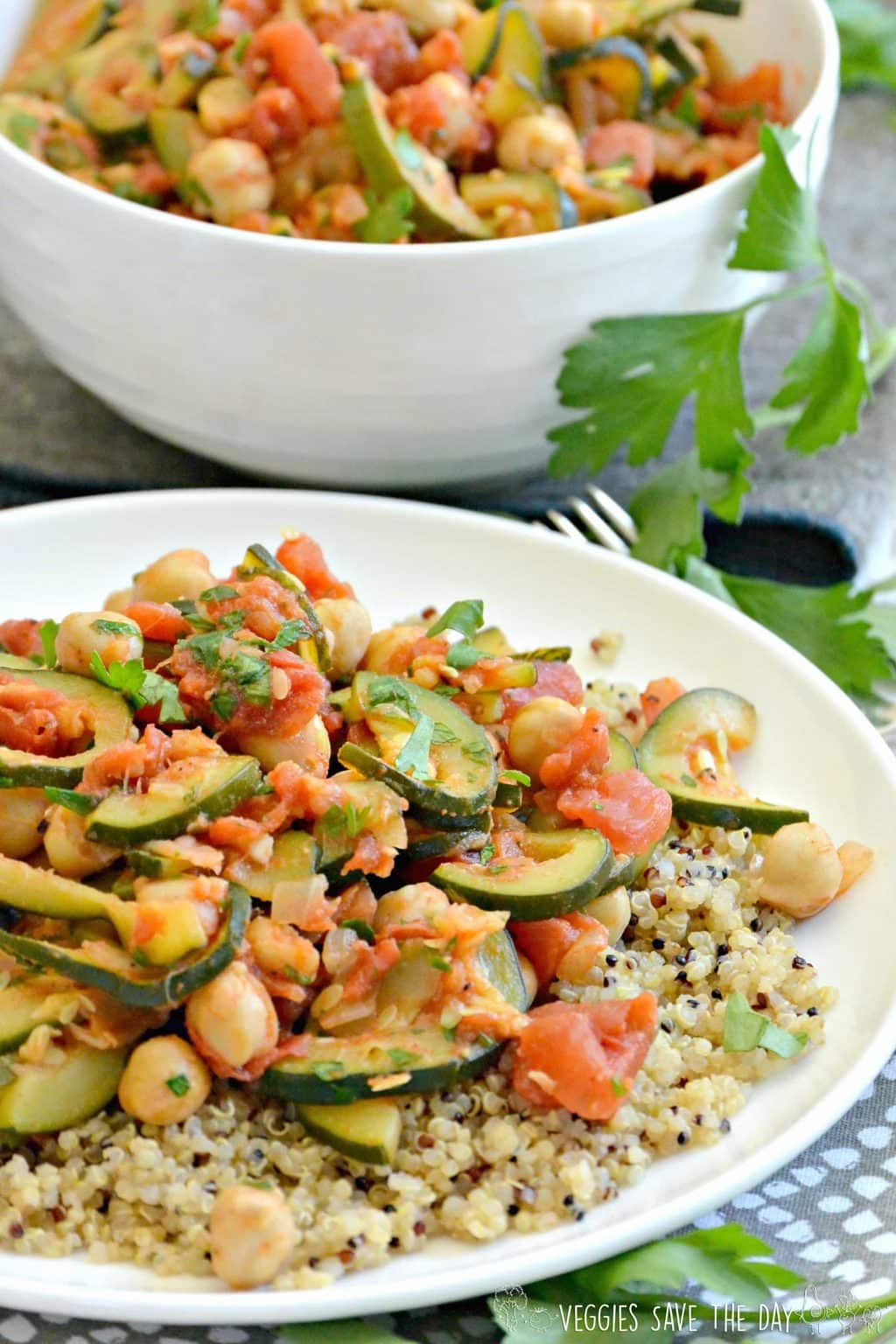 Plate of Zucchini Chickpea Stew served over cooked quinoa. This dish can be enjoyed hot or cold!