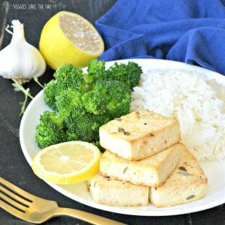Plate of Baked Tofu Steaks with steamed broccoli and rice