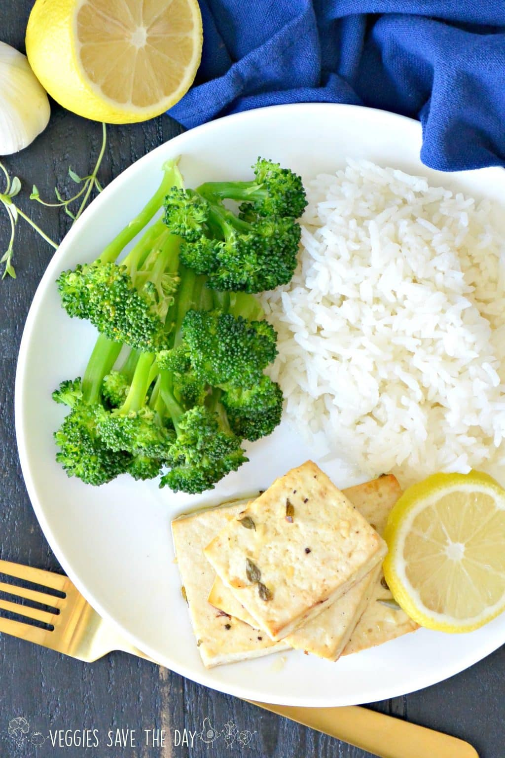 Overhead of plate of Lemon Baked Tofu served with broccoli and rice.