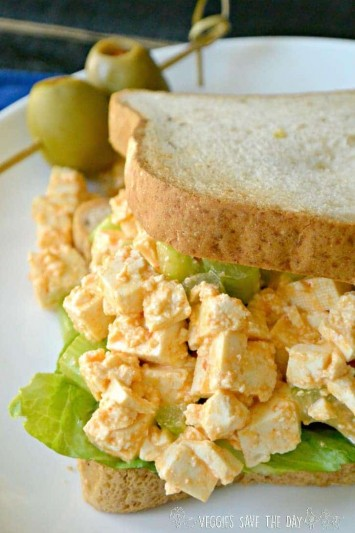 Close up of a Sriracha Tofu Egg Salad (Vegan) Sandwich with lettuce on gluten-free toast.