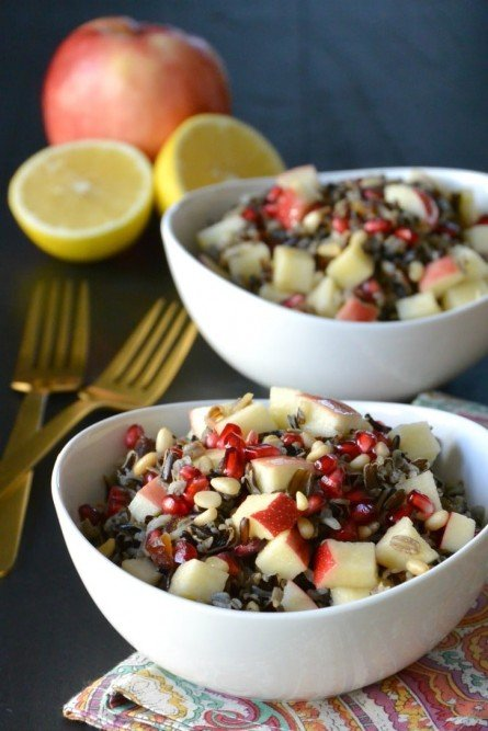 Wild Rice Salad containing apple, pomegranate, pine nuts, Medjool dates, and Meyer Lemon vinaigrette