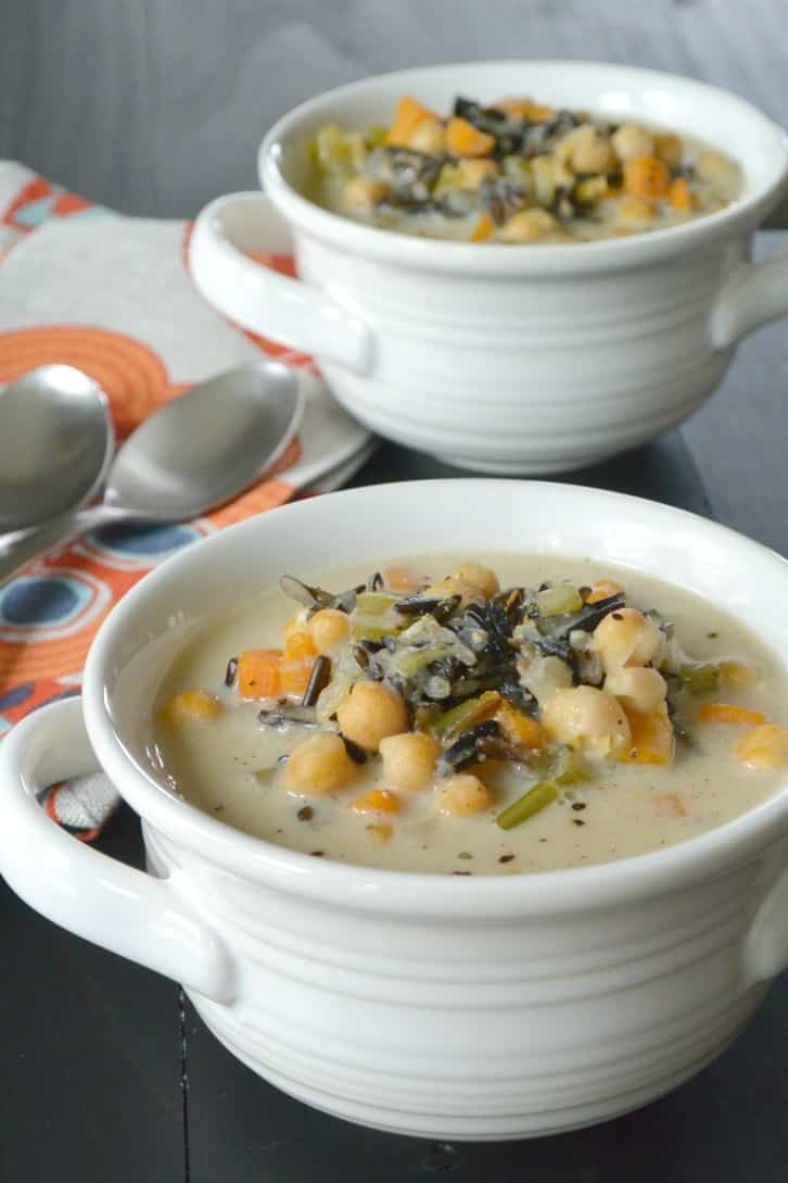 Vegan Wild Rice Soup made in an Instant Pot electric pressure cooker is creamy while being dairy-free and oil-free. It's made with chickpeas, carrots, onion, celery, thyme, and cashews.