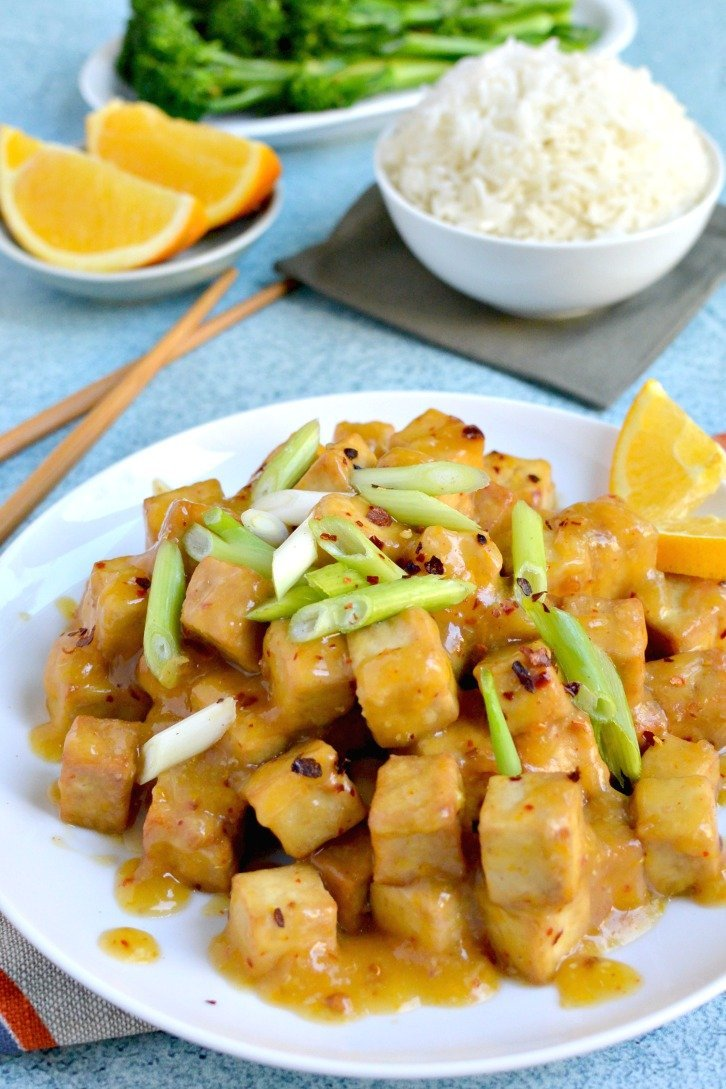 Air Fryer Orange Tofu (Oil-Free) with a delicious citrus and spicy sauce topped with green onions.