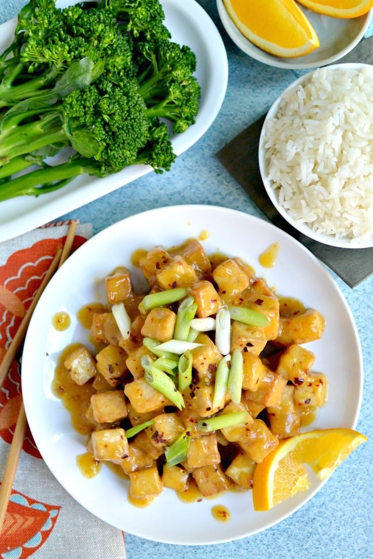 Air Fryer Orange Tofu (Oil-Free) served with steamed baby broccoli and jasmine rice.
