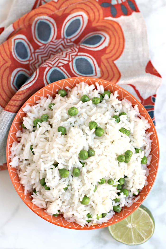 Serving bowl of Coconut Jasmine Rice with peas made in the Instant Pot pressure cooker