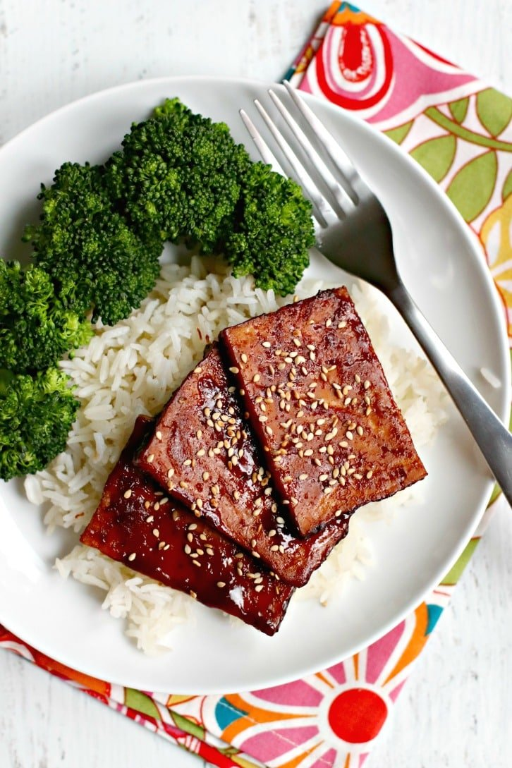 Overhead of plate of Baked Tofu Teriyaki on steamed rice with a side of broccoli