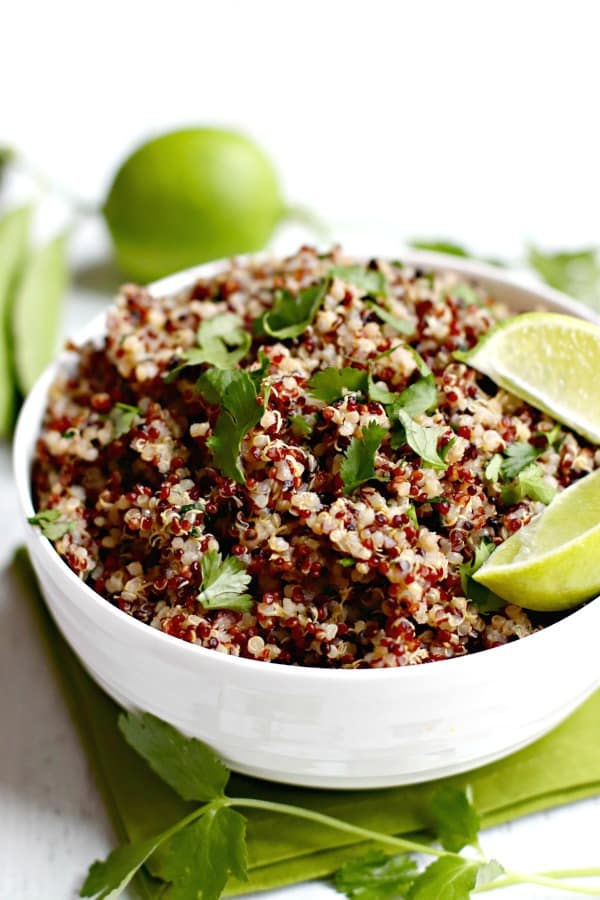 Cilantro Lime Quinoa is easy to make on the stove or in an Instant Pot pressure cooker. It's vegan, gluten-free, and oil-free. Enjoy it as a side with your favorite Mexican dishes or in a bowl with beans and vegetables. #quinoa #instantpot #vegan #glutenfree #oilfree