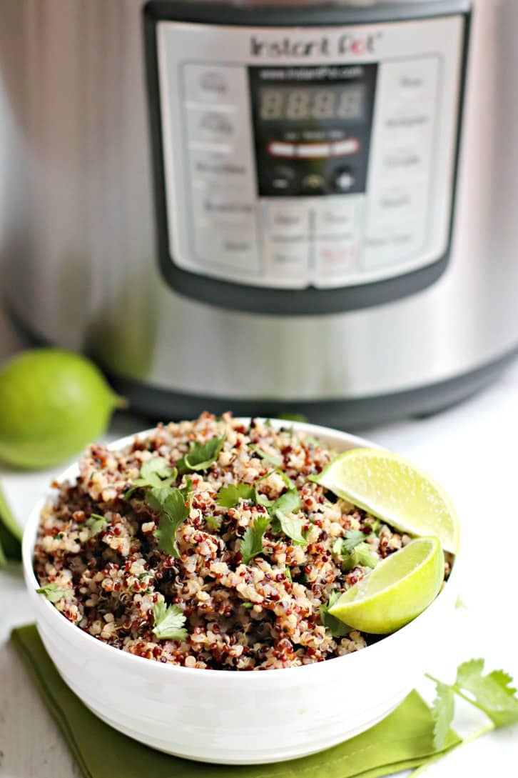 Bowl of Cilantro Lime Quinoa in front of an Instant Pot electric pressure cooker
