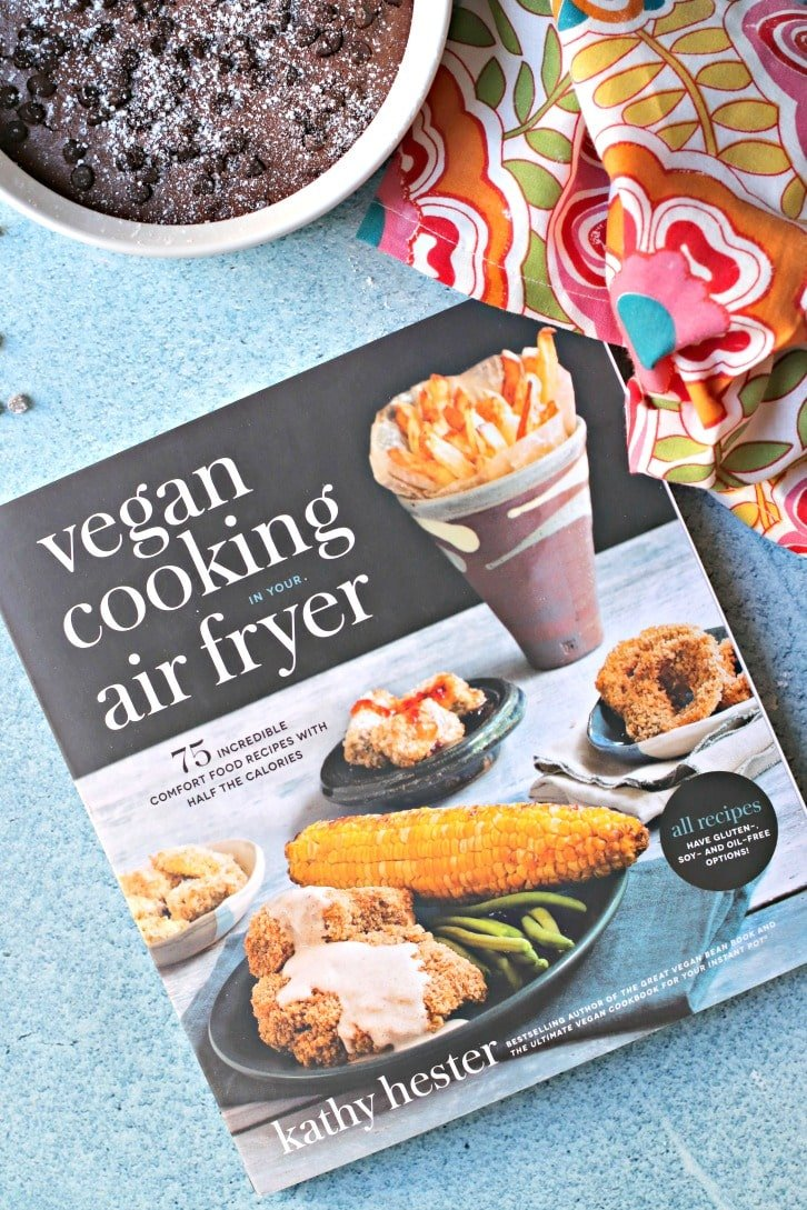 Overhead of the cookbook Vegan Cooking in Your Air Fryer by Kathy Hester and Small Batch Brownies