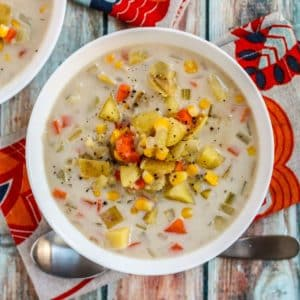 Bowl of chowder with a next to it