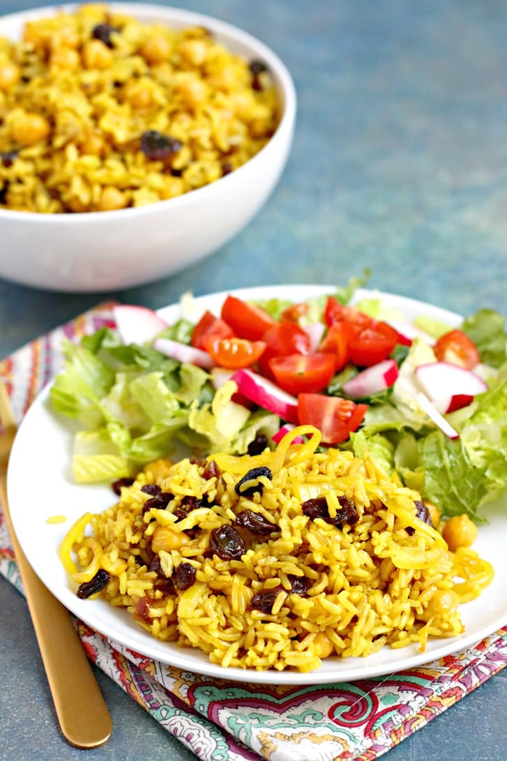 Basmati Rice Pilaf served with a green salad with tomatoes and radishes