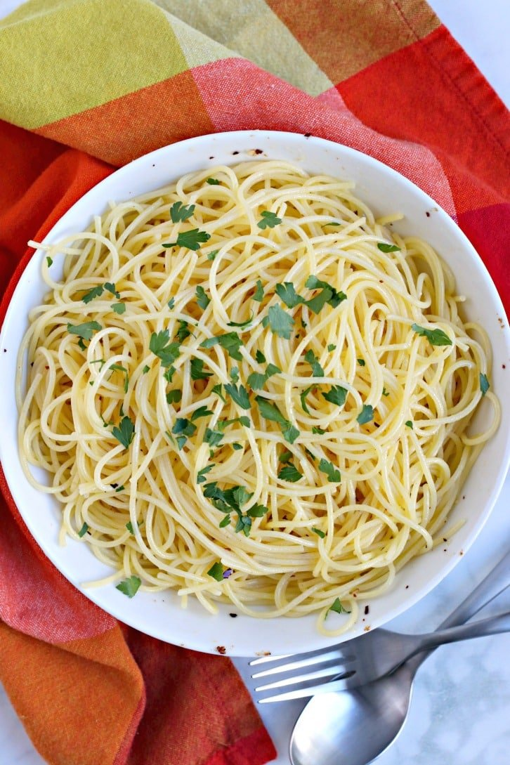 Spaghetti with Garlic and Olive Oil topped with fresh parsley
