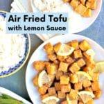 Table with plates of lemon tofu, rice, and sugar snap peas