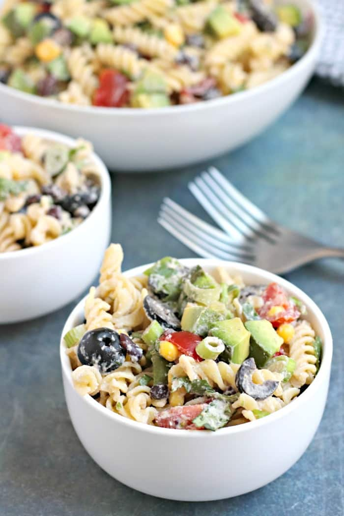 Two servings of Southwest Pasta Salad with Chipotle Ranch, and two forks in front of serving bowl