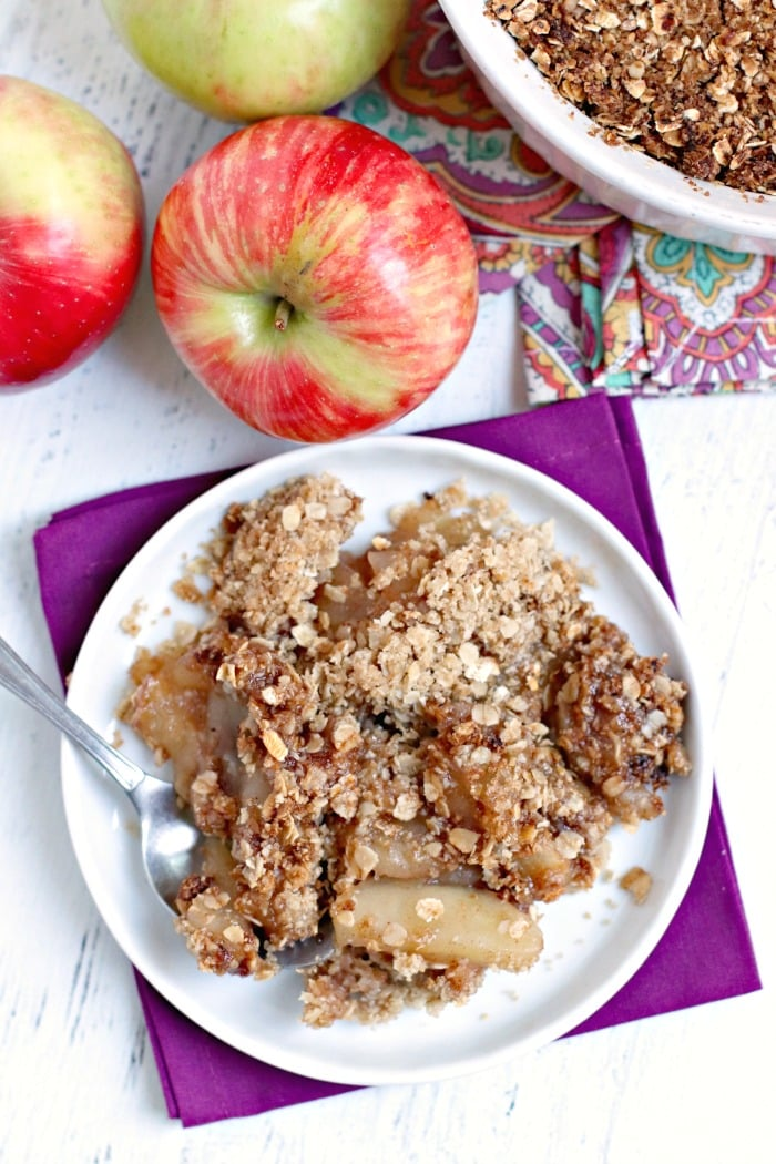 Overhead of serving of Vegan Apple Crumble with apples and fork