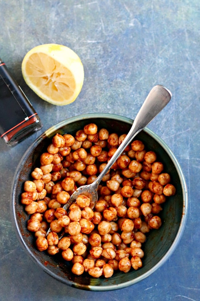 Bowl of chickpeas tossed with olive oil, salt, smoked paprika, and lemon juice