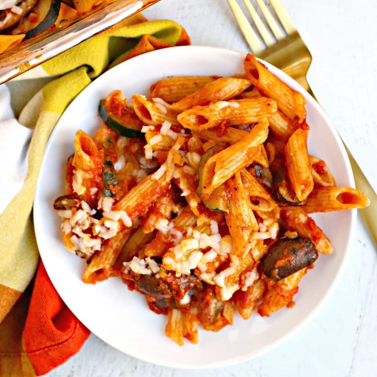 Baked pasta on a plate with a fork