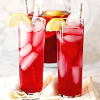 Glassed of Spiked Iced Tea garnished with lemon slices