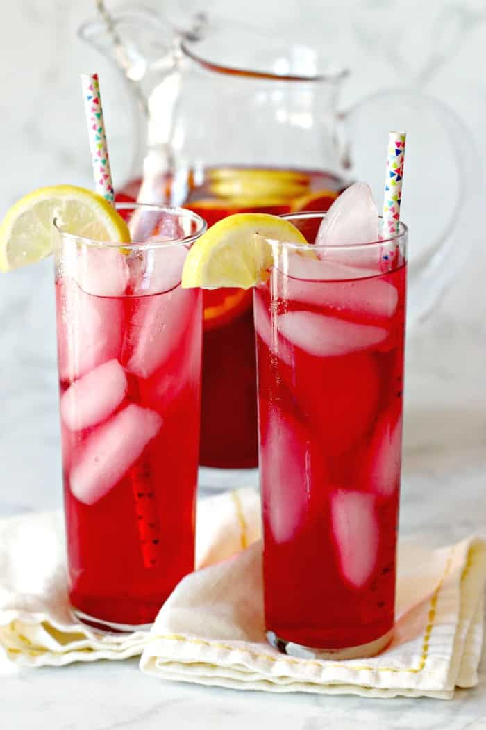 Glasses of Spiked Iced Tea in front of pitcher