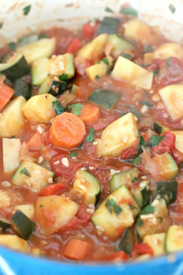 Finished stew topped with fresh parsley