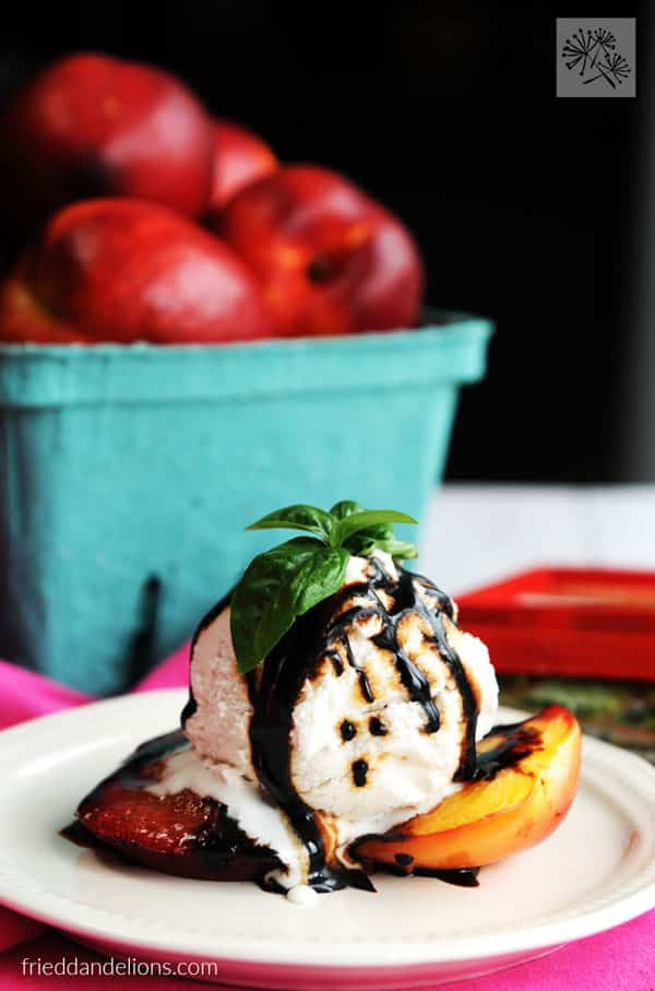 Grilled nectarines topped with vanilla ice cream and balsamic reduction