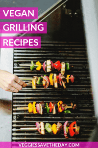 Woman's hand turning vegetable kabobs on an outside barbecue grill