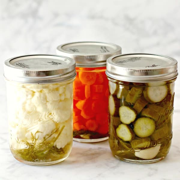 3 jars of refrigerator pickles made with cauliflower, carrots, and cucumbers
