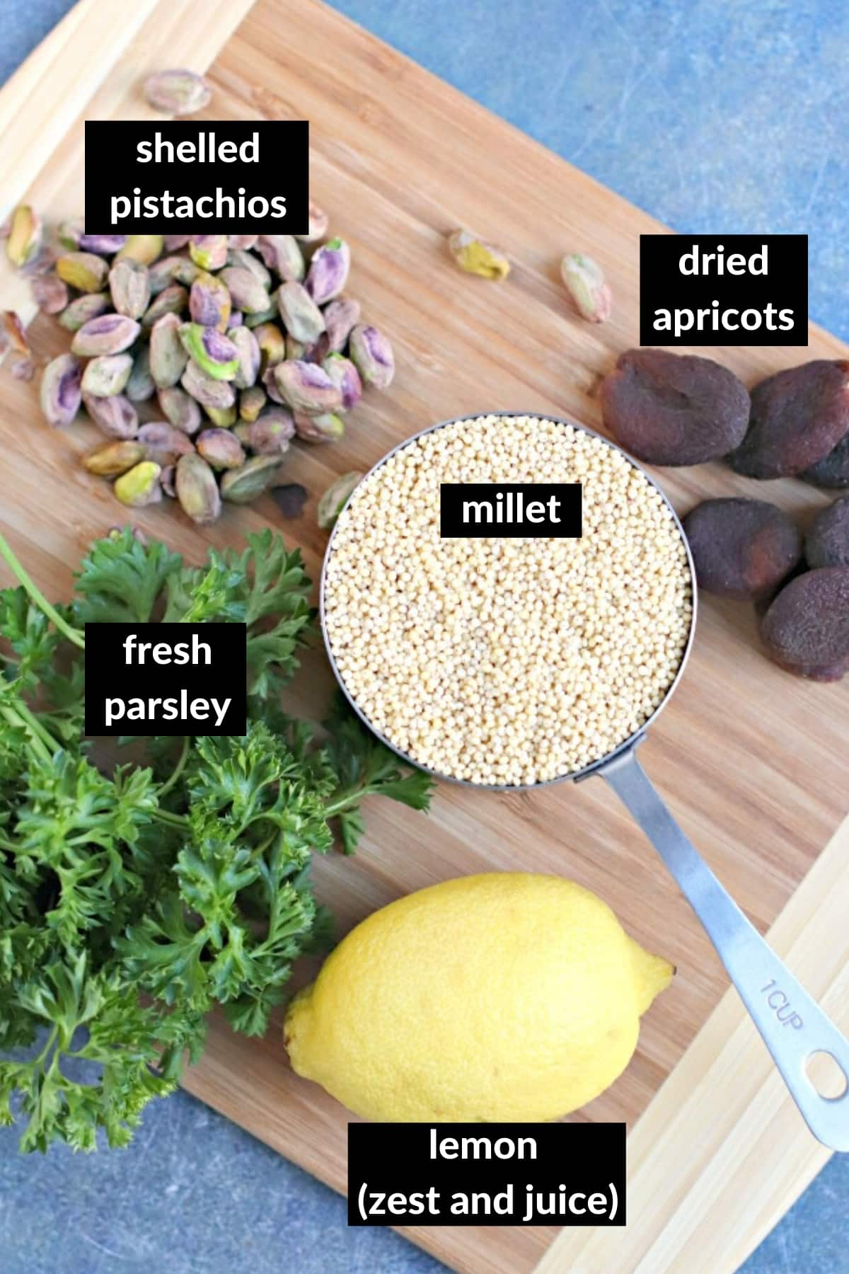 Ingredients needed to make this millet recipe on a wooden cutting board