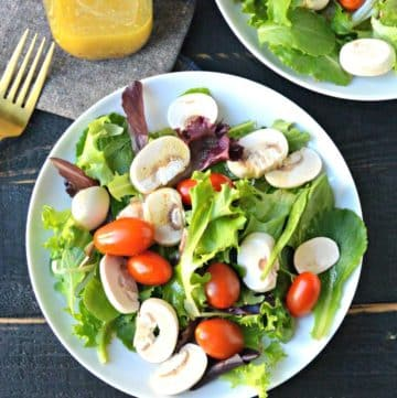Salad on a plate with tomatoes and mushrooms
