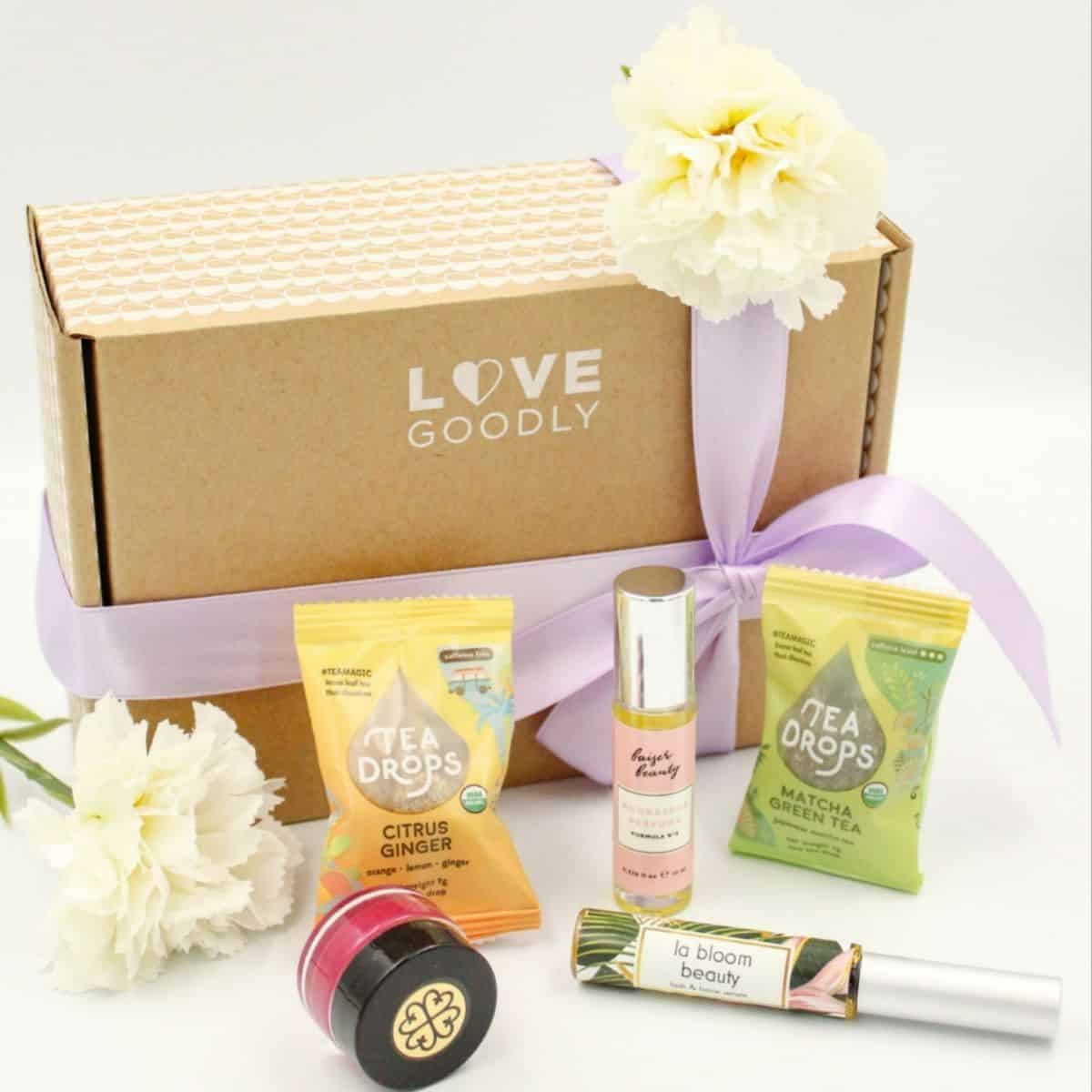 Love Goodly Box with products in front of it