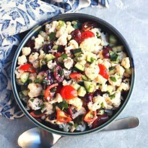 Bowl of Mediterranean Cauliflower Salad and serving spoon