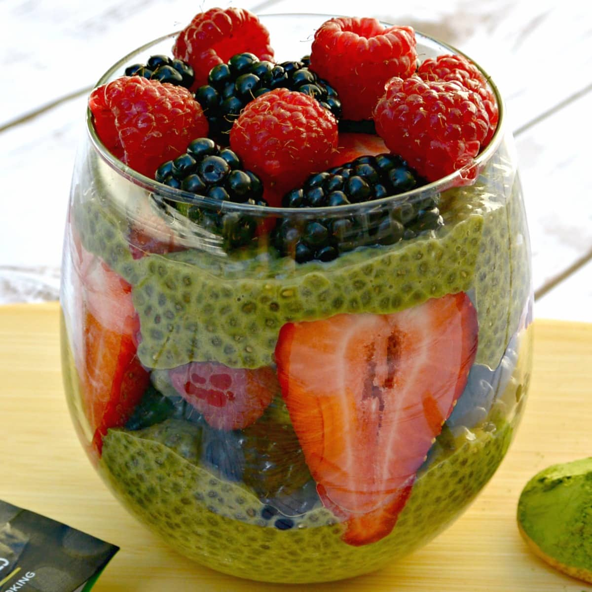 Matcha green tea chia pudding topped with raspberries, blackberries, and strawberries