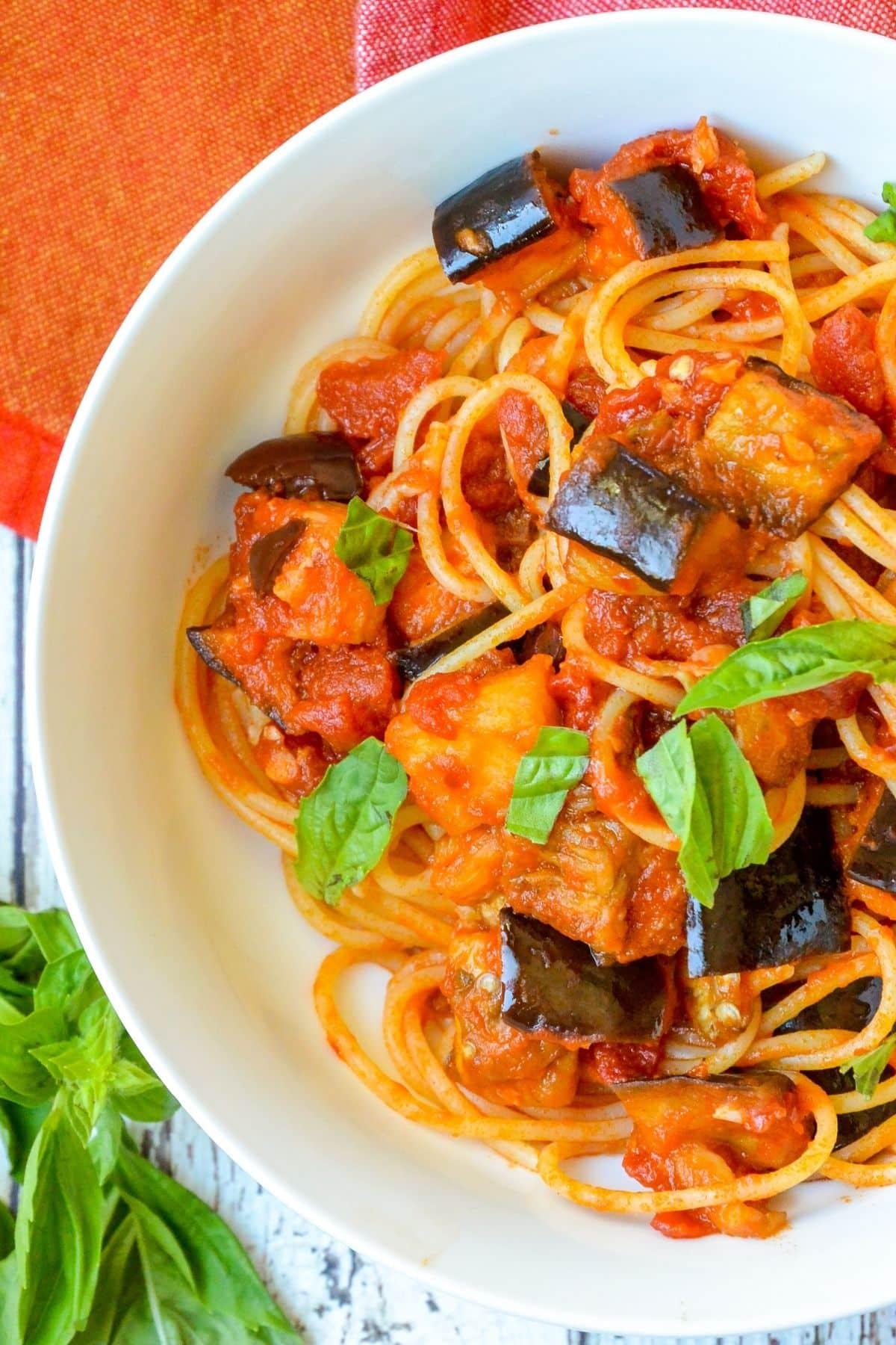 Close up of finished pasta recipe garnished with fresh basil