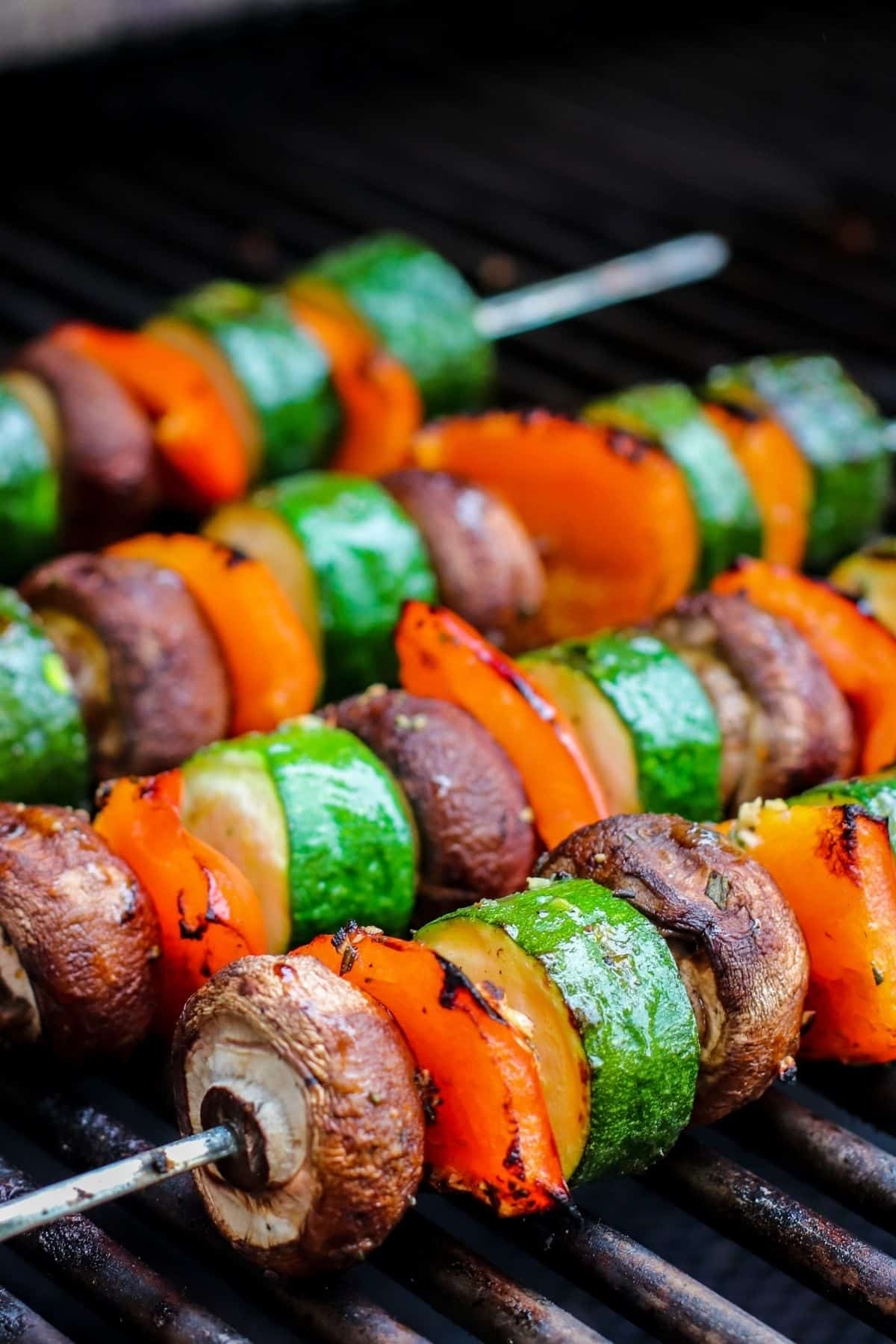 Close up image of vegetable kabobs on a barbecue grill