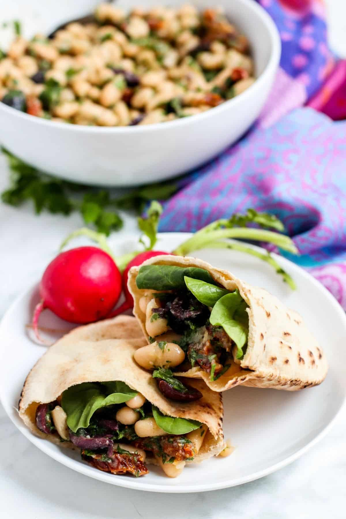 Pita pockets stuffed with spinach and white bean salad