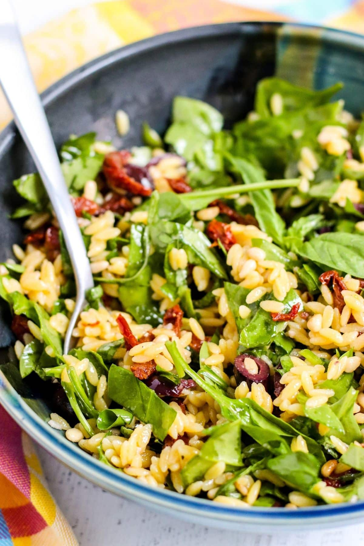 Close up detail of salad with a serving spoon in it
