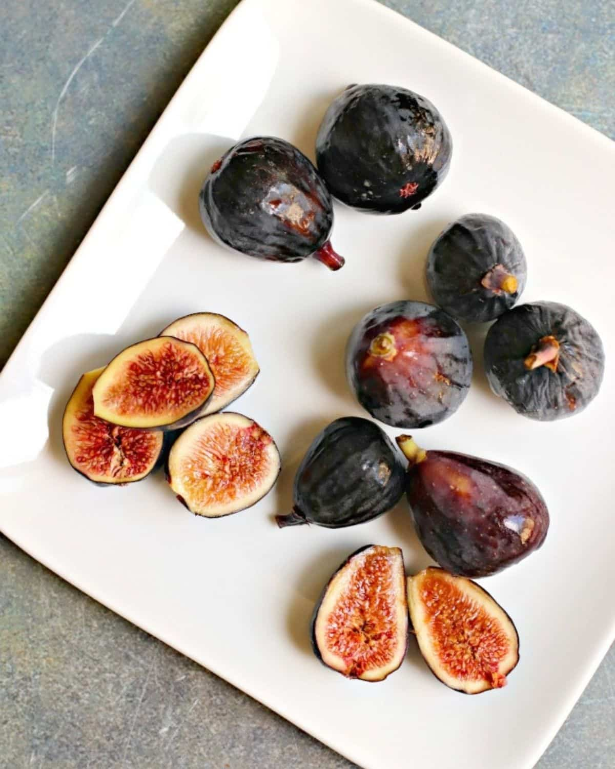 Plate of fresh figs with some of them sliced open