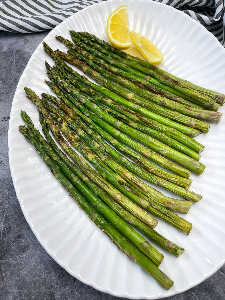 Platter of asparagus with lemon wedge