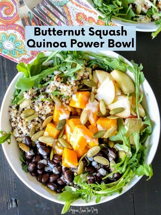 Bowl with arugula, butternut squash. quinoa, black beans, and apples.
