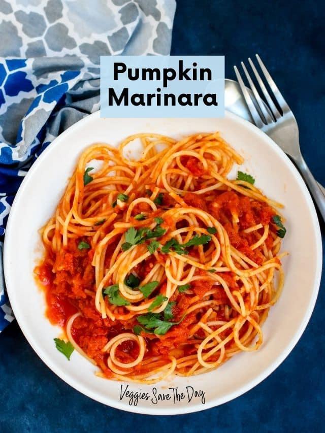 Bowl of spaghetti with pumpkin marinara sauce and fresh parsley.