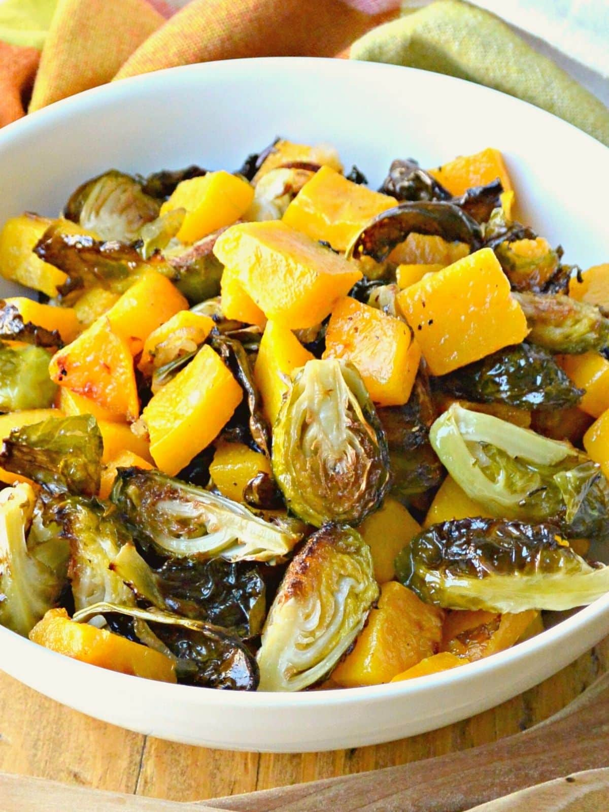 Close up of bowl of butternut squash and Brussels sprouts.